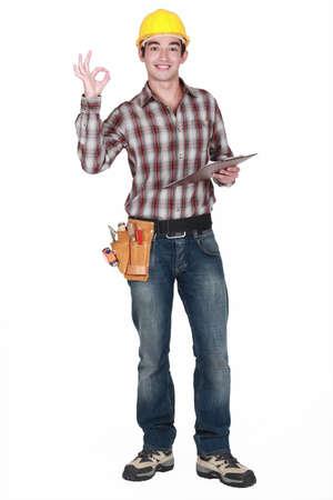 tasker: Builder holding clip-board making OK gesture
