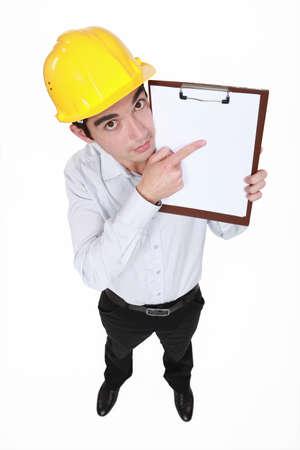Man with helmet pointing portfolios Stock Photo - 19693447