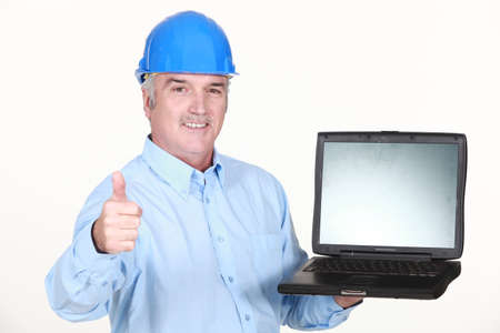 commend: Thumbs up from an engineer with a laptop