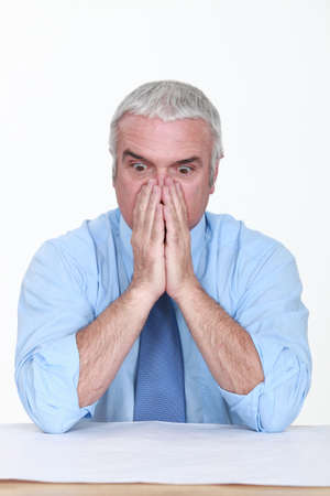consternation: Appalled man looking at a blueprint Stock Photo