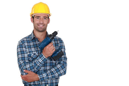 cordless: Worker holding cordless drill Stock Photo