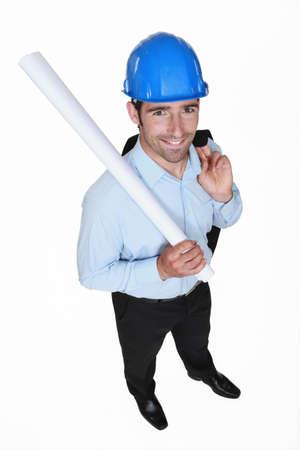 handsome businessman holding a blueprint Stock Photo - 19693365