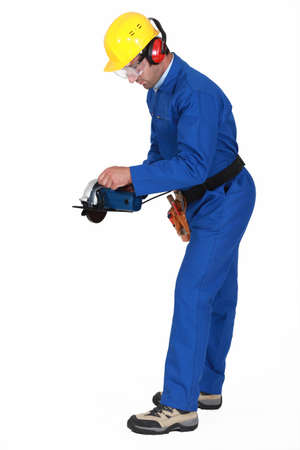 Tradesman holding a circular saw photo