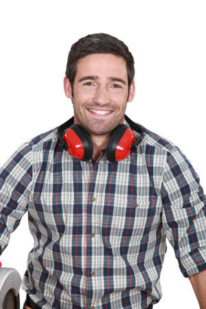 ear muffs: Man wearing protecting ear muffs