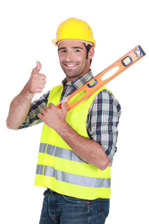 leveler: Man with spirit-level giving the thumbs-up