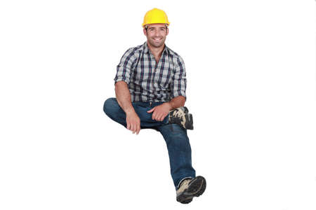 levitating: A construction worker levitating.