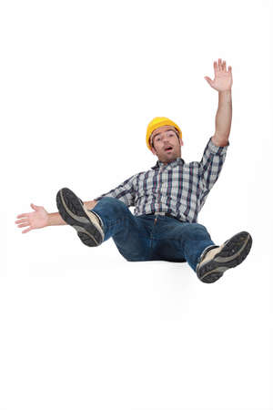 failing: Tradesman falling through the air Stock Photo