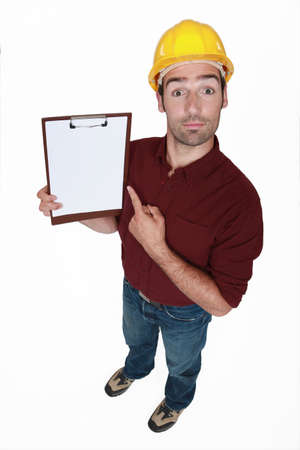chirpy: Chirpy builder pointing to clip-board Stock Photo