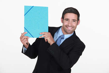 all smiles: businessman all smiles holding file