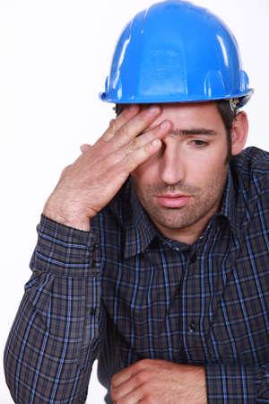 err: Engineer with a headache Stock Photo