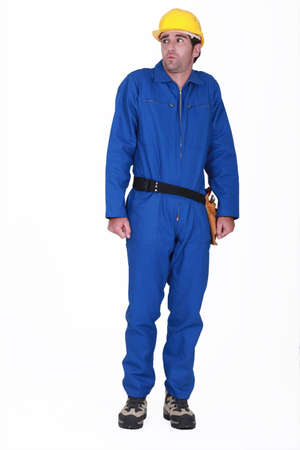 scolded: tradesman in blue jumpsuit being scolded