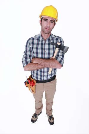 grouch: Grumpy tradesman holding a hatchet