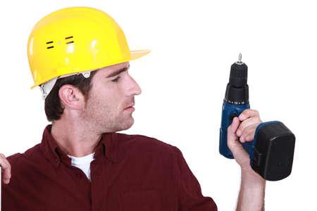 amend: Man holding cordless drill