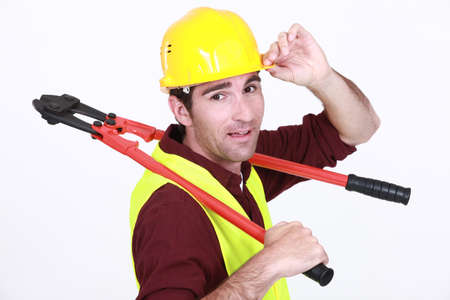 jobbing: Construction worker with boltcutters Stock Photo