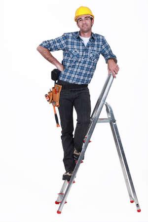 An handyman on a ladder.