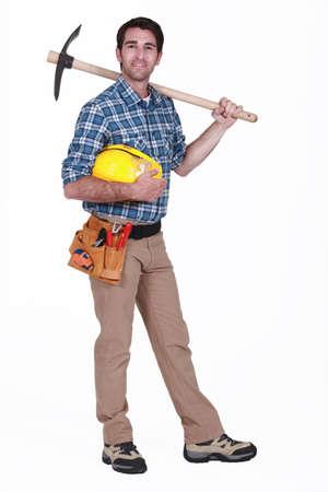 Laborer holding pickaxe