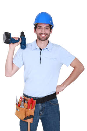 happy craftsman holding a drill photo