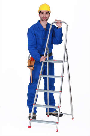 Worker with a stepladder photo