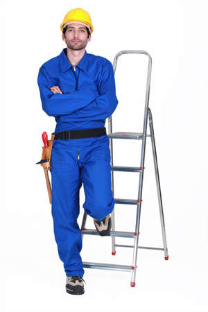 Portrait of a standoffish tradesman with his arms crossed photo