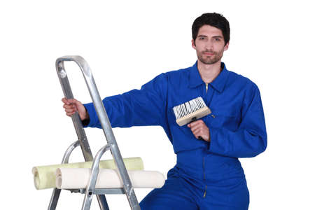 craftsman painter climbing on a ladder photo