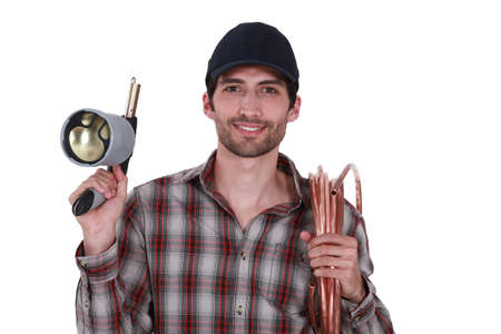 soldered: Plumber with blow-torch and copper pipe Stock Photo