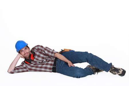 unconcerned: Comerciante en el suelo Foto de archivo