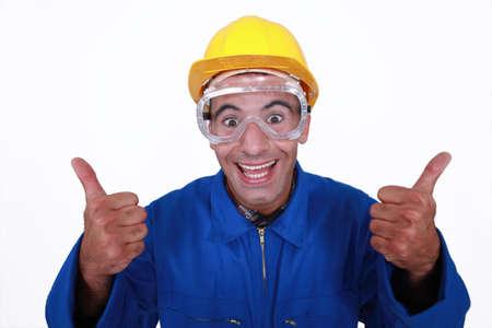 Verrückte Builder mit dem Daumen-up Standard-Bild