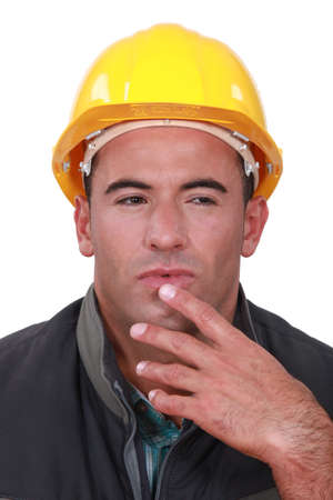 speculating: Portrait of a doubting tradesman Stock Photo