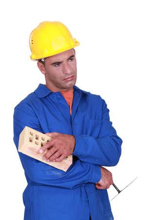 crestfallen: Sad bricklayer