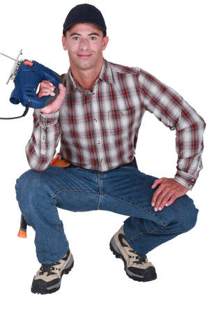 odd jobs: Handyman holding a jigsaw Stock Photo