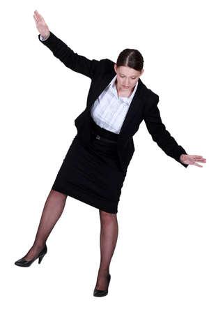 female businesswoman miming tightrope walker Stock Photo