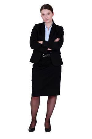 secretary skirt: businesswoman in a suit posing