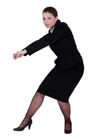 struggling: Businesswoman pull action Stock Photo