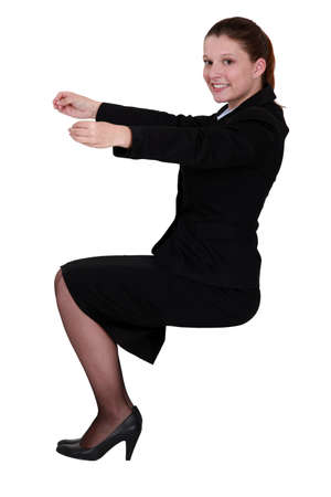 Businesswoman holding an invisible object photo