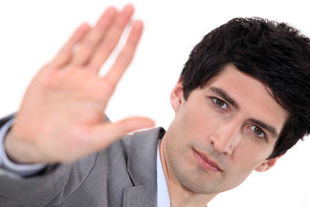 Businessman holding his palm up photo