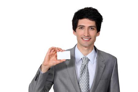 brandishing: Man brandishing business card Stock Photo