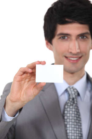 personalised: Businessman holding up a blank business card
