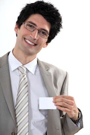 businesscard: Businessman with glasses showing off business-card