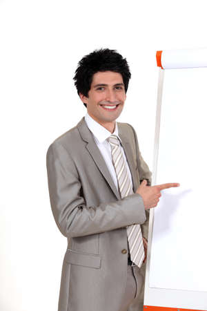 Businessman pointing to a flip chart photo