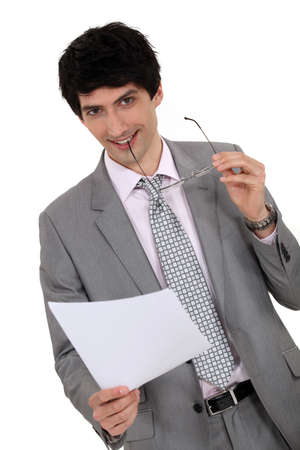 hiss: Businessman holding hiss glasses and sheet of paper