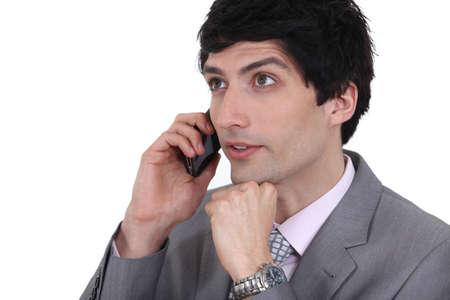 dishy: dishy businessman on phone with dreamy eyes Stock Photo
