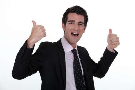 Portrait of a businessman rejoicing photo