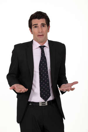 shrug: A clueless businessman. Stock Photo
