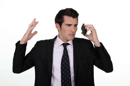 An angry businesswoman over the phone. photo