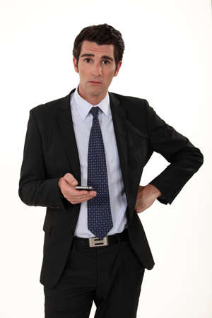 dazzled: Businessman surprised by text message Stock Photo