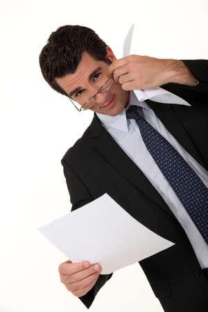 observant: Intelligent businessman reading a document