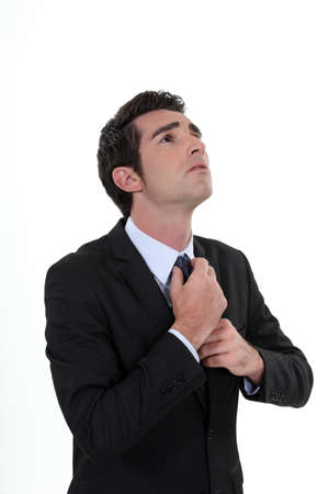businessman tightening tie photo