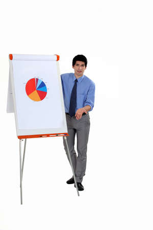 flip chart: Man stood by flip-chart giving presentation