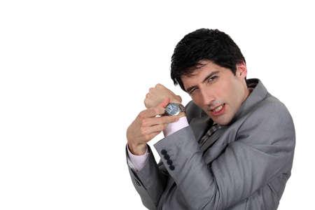 disdain: Hombre de negocios que empuja el tiempo