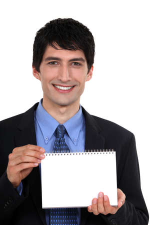 Man showing blank page on a notebook Stock Photo - 19695746